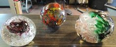 Paperweights done at Fireworks Glass Studios, the center and right done by Ron Baker II