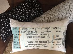 Concert ticket pillow. I enlarged a keepsake concert ticket that was signed, and ironed it on to fabric to create a unique pillow.