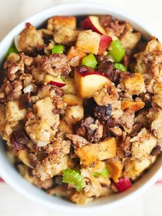 This best ever sausage stuffing is salty from the sausage, crunchy from the bread cubes, sweet and tart from the red delicious apples! Move over turkey, this best ever stuffing is ready to take the main stage! www.showmetheyummy.com #stuffing #thanksgiving