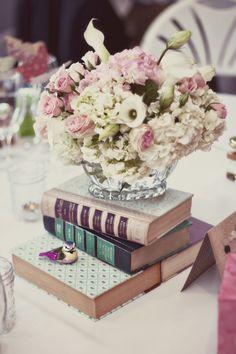 Books as centerpiece base - Photo Source • Koontz Photography