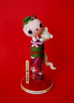 """""""Overly Familiar Familiar"""" handmade felted kokeshi doll by Hine for """"Plush You"""" 2009 group show"""