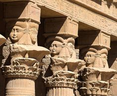 """Temple of the Goddess Isis at Philae (now on the Agilkia island): detail of three of the seven Hathoric columns (first three from the Second Pylon) on the east exterior side of the """"House of Birth"""" (the Mammisi)"""