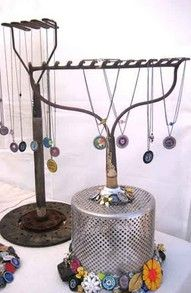 WHAT! cute! great necklace display.... or even leave it tall and hang scarves or coats. the one in the back looks like a potato smasher :)