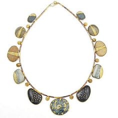 Patina Gallery SOFA preview. Necklace, 18K Yellow Gold, Sterling Silver, New Zealand Beach Pebbles. Pebbles have 18K Yellow Gold Reticulation.