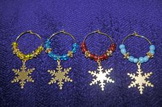 Snowflake Wine Charms. 4 Gold Snowflake Charms beaded in different colored beads. - pinned by pin4etsy.com