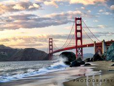Crashing wave at Marshall's Beach near the Golden Gate Bridge at sunset