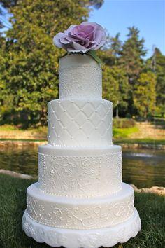 White wedding cake with sugar lacework