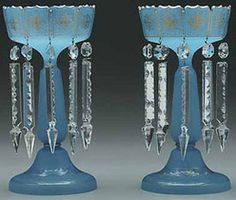 lighting, America, A pair of unattributed blue frosted glass lustres, gilt highlights, hung with prisms, Circa 1876-1925