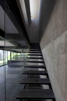 Modern Stairs // glass, steel and concrete stairs at the Agustin Landa Ruiloba - Casa Go, Nuevo Leon, Mexico