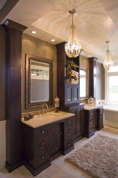 custom cabinetry; bathroom cabinets; cabinetry in bath; luxurious; elegant; dark wood; wooden; vanity; vanities; arches doors; recessed doors;double vanity; vanity with crown molding; vanity with tower; master bath