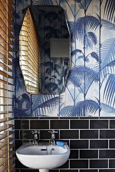 Blue palm tree wallpaper in bathroom, that's what I call beach house sophisticated! Via sfgirlbybay.