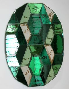 I love the emerald greens and the scribbled numbers on this decorative glass mirror, handblown by Sam Miller, at the 2012 Milan Furniture Fair