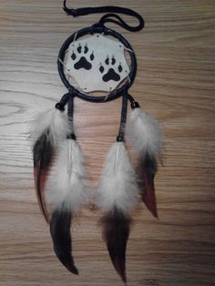 Welcome~    This listing is for a Hand Painted Wolf Paw Print Mandela with Natural, Tri Colored Feathers.    2 Wolf Paw Prints Hand Painted with