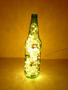 Upcycled beer bottle auto-rickshaw bottle lamp