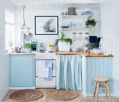 charming blue and white little beach house kitchen.