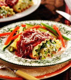 Tender #broccoli wrapped in #lasagna and topped with #tomato sauce and #Parmesan #cheese makes a #delicious midweek dinner.