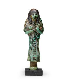 An Egyptian glazed composition shabti for May;  'For the royal scribe and director of the cattle of the Lord of the Two Lands, May, true of voice', 15.7cm high; 7/6/17