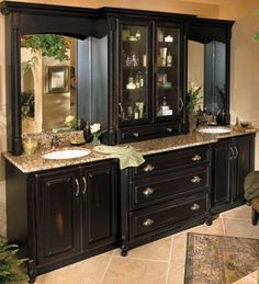 master bath, liking the dark cabinets, need more storage like the glass doors
