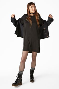 A t-shirt dress cut from a velvety soft modal blend fabric, with small slits on each side.