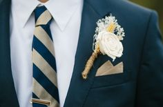 Close up of the boutineers I made for my wedding. Less than $5 each and took about 10 minutes to make. Sola flower, ivory boutineer, striped tie, navy and champagne, groom wedding style, navy groom, casual wedding, laid back groom style.