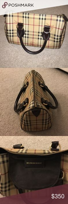 Burberry handbag This authentic leather Burberry handbag has minimal stains on the inside. The outside has one slight scratch at the bottom, otherwise it is in great condition. Burberry Bags Totes
