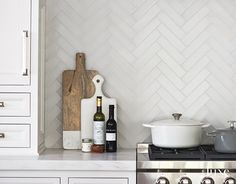 Matte glass herringbone tiles make for a beautiful backsplash #TileTuesday…