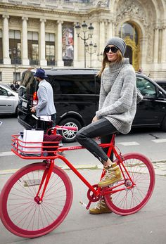 Nadja taking bike chic to a whole new level with that knit/beanie combo. #offduty in Paris. #NadjaBender