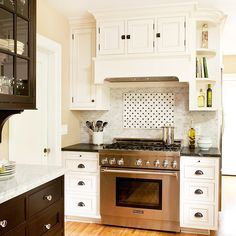 Classic Elegance  Stone mosaic tile complements the traditional character of this kitchen and enhances its upscale look