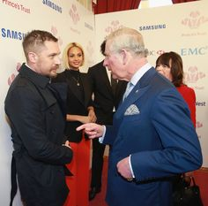 Prince Charles, Prince of Wales meets actor Tom Hardy as Alesha Dixon looks on as they attend The Prince's Trust Celebrate Success Awards at London Palladium on March 7, 2016 in London, England.