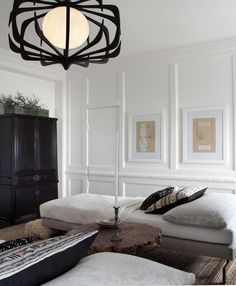 Michael del piero | black, white + brown tones with modern black, metal chandelier + lounge spot