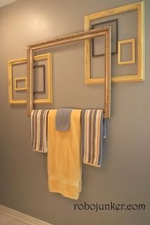 Create a towel bar using pretty frames with this DIY.