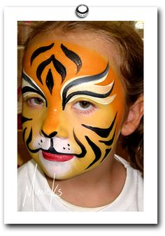 tiger face painting by mimicks face painting