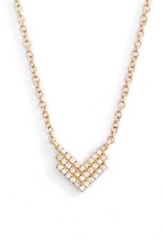 Petite and perfect for everyday wear, this luminous 14-karat-gold necklace features an angular chevron pendant traced with glittering pavé diamonds.