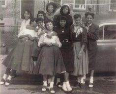 A gaggle of African American beauties wearing typical 1950s attire