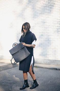 Navy long turtleneck, white shirt dress, black boots and oversize grey backpack.
