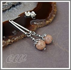 Silver earrings with sunny stone.