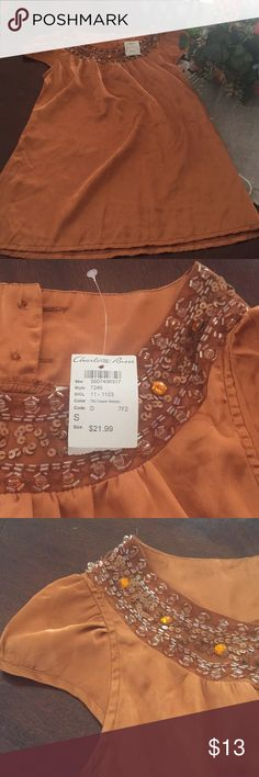 Shirt closet clear out Beautiful golden color with sequins around the neck. New Charlotte Russe Tops