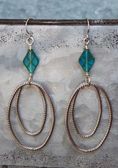 """Bring on the fun in these remarkable dangle earrings, featuring Czech glass beads and silver metal rings dangle below.   •Measures 2-3/4""""   •French hooks ➡️ https://www.etsy.com/listing/474527946/aqua-glass-and-silver-hoop-earrings-long?utm_campaign=products&utm_content=1d47eac5ab5e48c8b491a7c8ab568a4d&utm_medium=pinterest&utm_source=sellertools"""