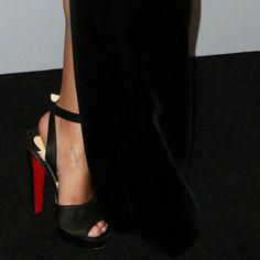 b4170dfa449 Zoë Kravitz showing off her feet in black suede Christian Louboutin   Louloudancing  heels Celebrity