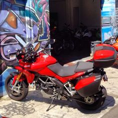 Look at how TERRIFIED the wall is of the Ducati Multistrada behind Scuderia in Mission