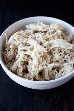 This ridiculously easy, tender, and juicy slow cooker shredded chicken is perfect for so many recipes and the shredded chicken can be frozen for later!