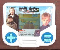 Vintage 1988 HOME ALONE 2 LCD Tiger Electronics Handheld Electronic Game TESTED ..starting bid $9.99!!