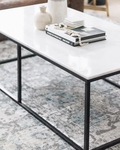 With a sleek metal base and a gorgeous quartz top the Yinnie Coffee Table makes a bold but understated statement in any livingroom Dimensions: X X H Material: Metal and Quartz Please allow weeks for delivery. Cozy Living Rooms, Living Room Interior, Home Interior Design, Painting Shiplap, Shiplap Ceiling, Inset Cabinets, Wood Grain Texture, Entry Way Design, Two Tone Kitchen