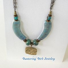 Original work by Bantering Bird Jewelry, love the Blue Banana Beads from Unicorne Beads.  I've used Banana Beads, too. VTP