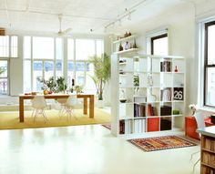 IKEA SPOTTED // EXPEDIT bookcase in white - I like the idea of the bookcase dividing the room, definitely something to think about an consider for small spaces in LA. Ikea Expedit Bookcase, Ikea Shelves, Shelving Units, Bookshelf Wall, Ikea Kallax, Oak Dining Table, Dining Room Chairs, Eames Chairs, Wood Table