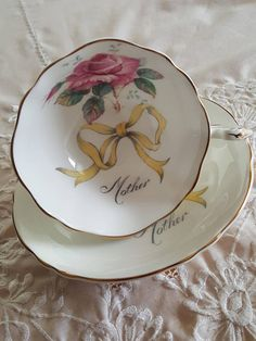 This would make a wonderful Mothers Day or Mom-to-be gift! Vintage Paragon china tea cup and saucer, made in England. White background with a solo pink cabbage rose and a script font that reads Mother on the inside of the cup. It is in good condition, no chips, cracks or