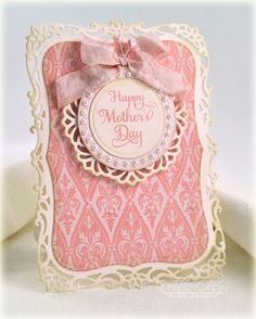 handmade Mother's Day card ... gorgeous look with brocade pattern, lacy die cut frame and silky ribbon ... monochromatic pink ... luv it!!!