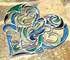 Stained Glass Blue Heart Window Ornament in an Intricate Tribal Motif