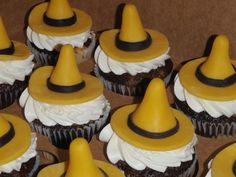 Man in the Yellow Hat - I made these to match a Curious George cake that the mother of the birthday boy made. Hats are candy clay. Marble cupcakes with IMBC :-)