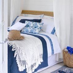 Climb into a cool bed and slumber beneath a voile canopy. Mix embroidered sheets with knitted throws and add a woven rug for cottage-style charm.  Another good choice for the main guest bedroom.